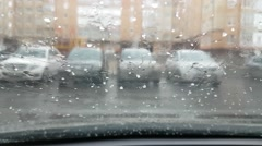 Hail falls on windshield of car parked in the yard Stock Footage