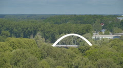 Big green trees and the bridge overview in Tartu Stock Footage