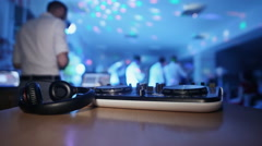DJ turntable at a party with dancing people Stock Footage