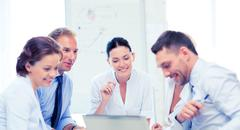 business team having meeting in office - stock photo