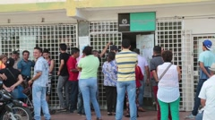 Venezuelans stand outside Columbia Border office awaiting entrance (HD) Stock Footage