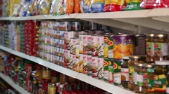 Pan of cans in Latin American store (HD) Stock Footage
