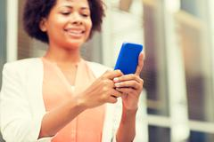 Close up of african woman with smartphone in city Stock Photos
