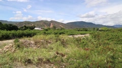 Pan Shot of Countryside and Venezuela/Columbia Border with Venezuela Sign Stock Footage