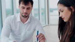 Young woman and man working together, cooperating Stock Footage