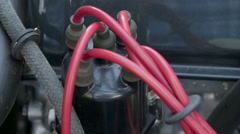 Red and black wires from the engine car Stock Footage
