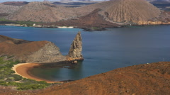 Zoom in shot of pinnacle rock in the galapagos islands Stock Footage