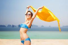 woman in bikini and sunglasses over infinity pool - stock photo