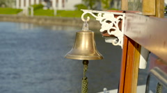 The golden bell on the side part of the boat Stock Footage