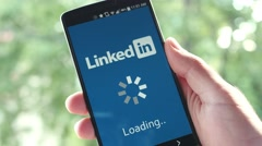 4K Linkedin app on Smartphone Loading Screen - Social Media Stock Footage