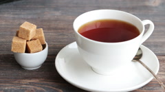 Cup of hot steaming black tea Stock Footage