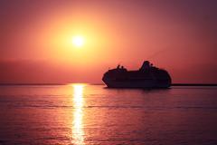 Cruise Ship at Sunset. Majestic Background. - stock photo