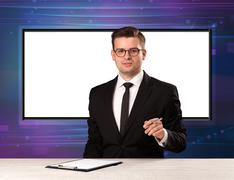Television program host with big copy screen in his back Stock Photos