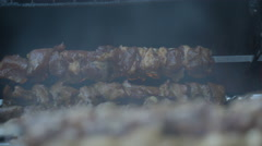 Pork meat barbecue being grilled on the heat - stock footage