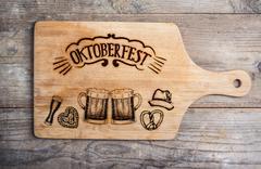 Oktoberfest sign with various hand drawn symbols, cutting board Stock Illustration