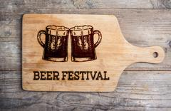 Beer festival sign with two beer mugs, cutting board Stock Illustration