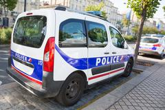 Closeup of body of police car with a sign POLICE. Stock Photos