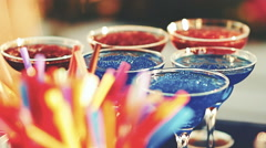 Cocktail party in the open air in the summer sun with colorful drinks - stock footage