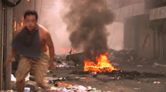 Man Runs Refugee Bombing Street Terrorist Attack Suicide Bomb Burning  City. Stock Footage