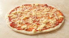 Garnishing with mozzarella a raw coal margherita pizza. Close up. Stock Footage
