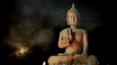 Serene yoga meditation composition, timelapse sunrise + candle lit Buddha statue Stock Footage