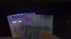 Mexico Pesos Blacklight Counterfeit Check Closeup Stock Footage