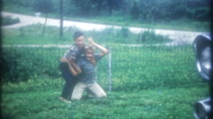 3491 boys wrestle around on the ground in the frontyard-vintage film home movie Stock Footage