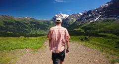 Young man hiking in Mannlichen, Switzerland Stock Footage