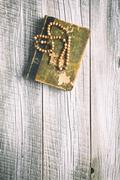 rosary beads and holy bible - stock photo