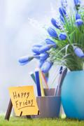 Adhesive note with Happy Friday text  at green office Stock Photos
