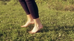 Happy Young Woman Jumping and Dancing on Grass Slow Motion - Graded Warm Look Stock Footage