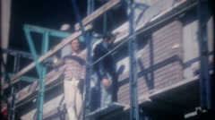 3493 bricklayers on scaffolding attached to building-vintage film home movie - stock footage