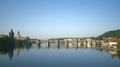 Charles bridge and Vltava river at early morning in Prague, Czech Republic Stock Footage