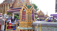 Tourists traveling at Wat Phra Kaew and Grand Palace in Bangkok Stock Footage