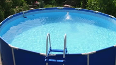 An empty blue swimming pool filled with still water. No people. Slow motion. HD Stock Footage