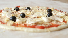 Grate cheese over tasty pizza Stock Footage
