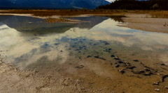 River Plain Mud Flats Mountain Timelapse tilt up Stock Footage