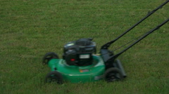 Lawn Mower being Pushed by Female. Stock Footage