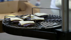 Chef remove burgers patty with cheese from grid  - stock footage