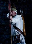 Medieval archer with a bow and arrows Stock Photos