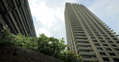 Brutalist architecture of the Barbican Estate, London: tracking, dolly shot Stock Footage