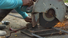 Worker Sawing cut Metal Line With a Circular Saw Sparks on Location building . Stock Footage