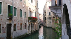 Romantic tour in gondola, rowed by a gondolier in the venice canal Stock Footage