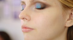 Close up beauty portrait shot of beautiful woman opening her eyes with makeup Stock Footage