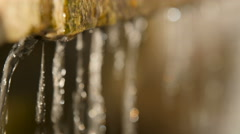 Close-up of the dripping water, in the sunlight. Stock Footage