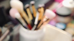 Set of a cosmetic brushes./ Makeup brushes on a table with other accessories for Stock Footage