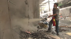 Man Sprays Fire Extinguisher After Bombing Terrorist Blast Explosion ISIS. Stock Footage
