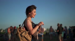 Woman drinking water on music fest Stock Footage