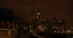 Flags Waving Behind the Parliament Buildings With Peace Tower in Background Stock Footage