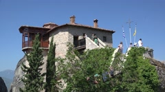 Tourists at the Nunnery of Rousanou / St. Barbara. Meteora, Greece Stock Footage